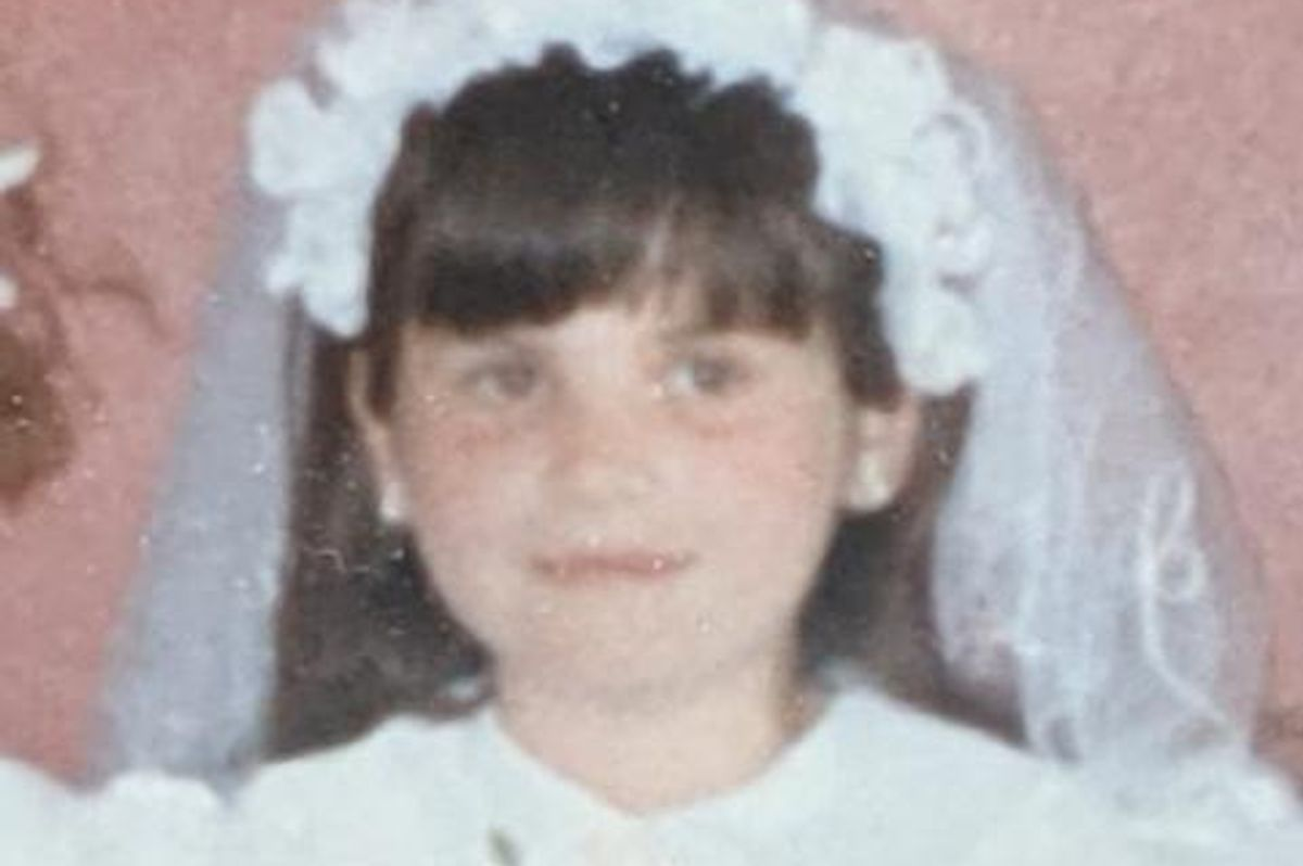 The author pictured in her first Holy Communion dress - she's a Catholic but not devout